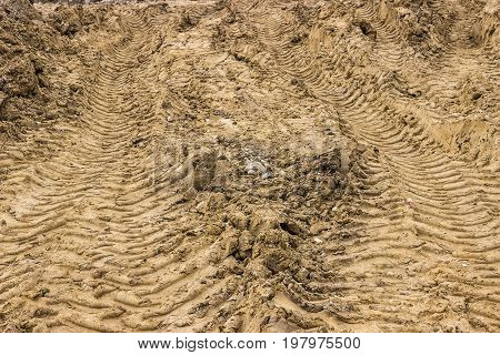 Truck Tyre Pattern On The Soil Background