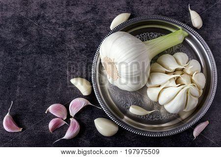 Fresh garlic on a dark background. Organic nutrition.