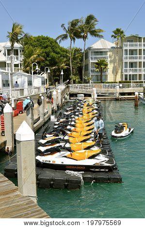 Key West Florida Keys Florida USA - May 15 2017 : Jet skis moored up in Key West Marina