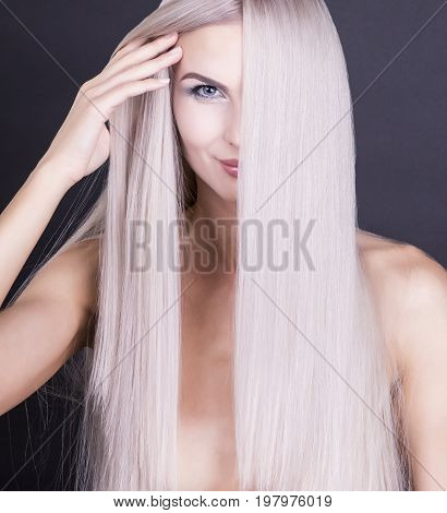 Perfect straight long grey hair studio shot