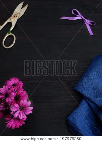 Dark background with tools for a florist or a designer. Florist or designer desktop