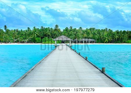 View of wooden pontoon at beautiful tropical resort