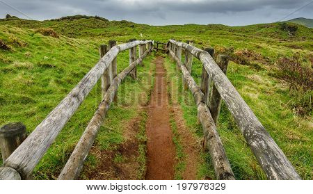 Wide view of track with wooden fences over Fumaroles, Furnas de Enxofre, Terceira, Azores, Portugal