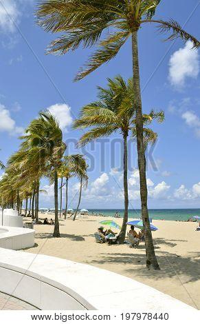Fort Lauderdale Beach Florida USA - May 16 2017 : Tourists on the beach enjoying the sun