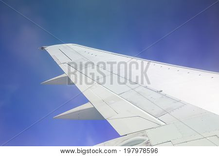 Aircraft wing over blue sky - close up