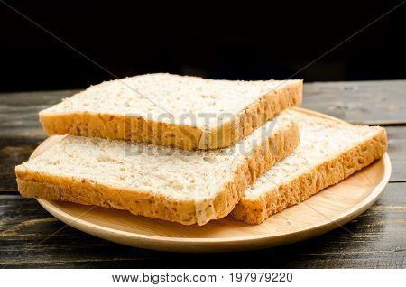 Sliced whole wheat bread on wooden dish,Healthy breakfast