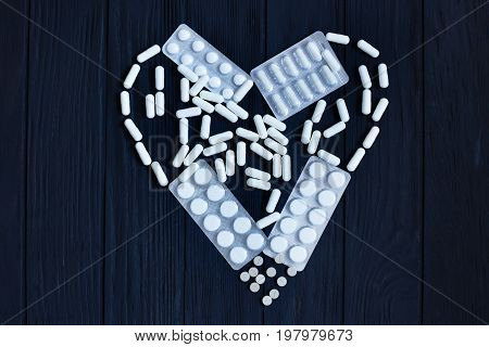 Tablets, Pill Capsules, Pill Blisters In Shape Of Heart On Black