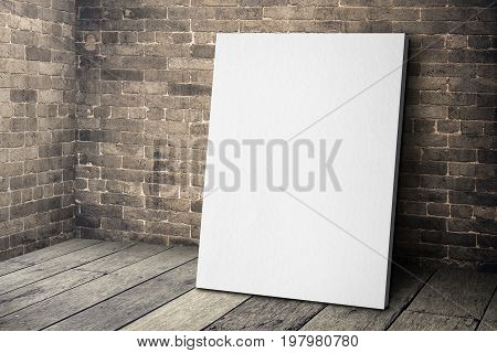 Blank White Canvas Frame Leaning At Grunge Brick Wall And Wood Floor, Mock Up Template For Adding Yo