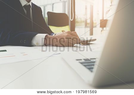 Close up business man signing contract making a deal at his office classic business