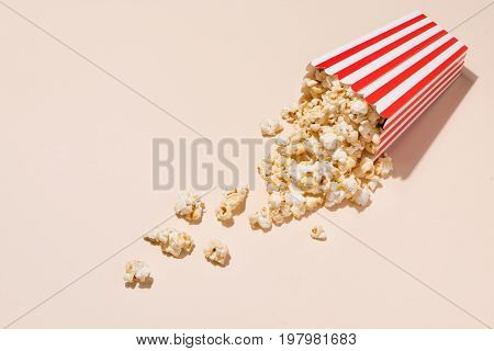 Popcorn In Red And White Cardboard With Glass Of Soda