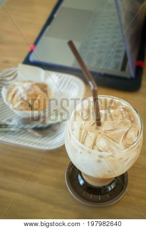 Blueberry muffin and iced coffee mocha stock photo