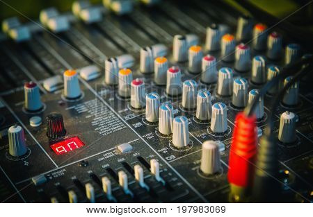 Professional audio equipment for audio mixer management selective focus close-up