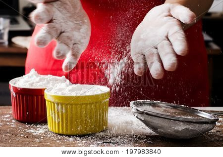 Hand sifting wheat flour into the bowl,bakery cooking