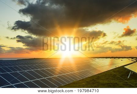 Solar Panels At Sunrise With Cloudy Sky In Normandy, France. Solar Energy, Modern Electric Power Pro