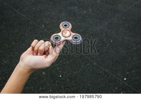 Spinner on the child finger. Modern popular game.