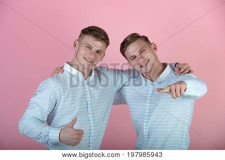 Models Smiling On Pink Background