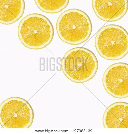 Seamless pattern of yellow lemon slices on white Background