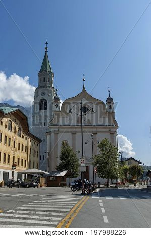 Cortina d'Ampezzo, Italy - September 24, 2011:  Autumnal corso Italia, the Church or Synagogue in the town centre of Cortina d'Ampezzo, Dolomites, Alps, Veneto, Italy, Europe. Visit in the place.