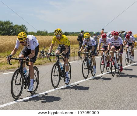Mailleroncourt-Saint-Pancras France - July 5 2017: Geraint Thomas in Yellow Jersey riding in the peloton between his teammates on a road to La Planche des Belle Filles during the stage 5 of Tour de France 2017.