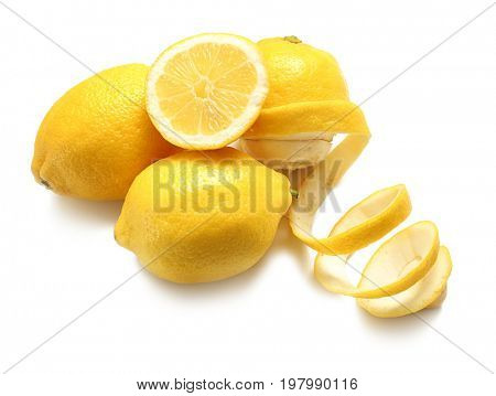Composition with ripe lemons and twist on white background