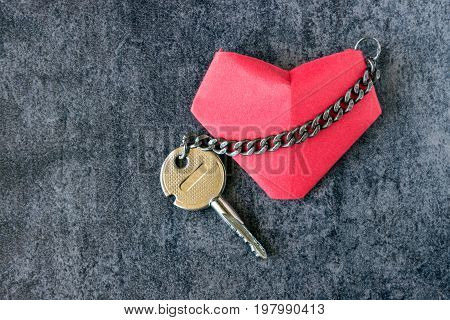 Heart and a key connected by a chain. Concept - love romance.