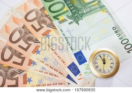 European banknotes like background and watch that have five to twelve time. Highest time for action.