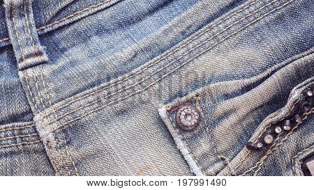 Denim jeans fabric texture background with seam studs and pocket for beauty clothing. fashion business design and industrial construction idea concept.
