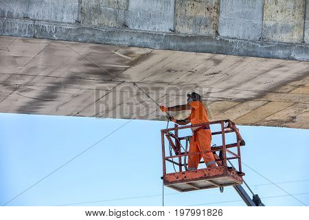 Worker On A Lifting Machine Works On The Construction