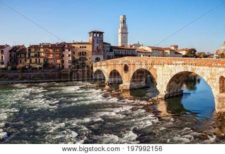 Ponte Pietra (Pons Marmoreus) and the River Adige  at  sunny morning, Verona, Italy.