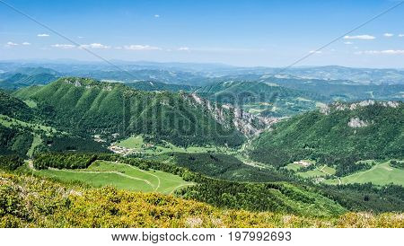 view to Vratna dolina valley with hills around from Poludnovy Grun hill in Mala Fatra mountains in Slovakia