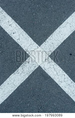 Top View Of White Parking Lines On Grey Roadway Background