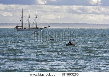 Large sailboat that comes out of the bar at the mouth of the river Tagus in Oeiras Portugal