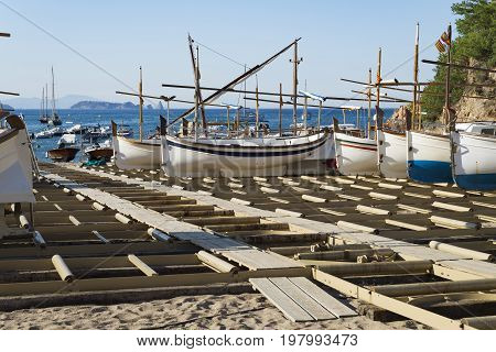 Traditional wooden boats in a dry dock in the Sa Riera beach at Catalonia Spain