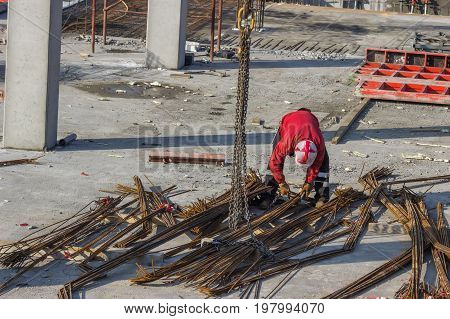Ironworkers Unload And Position Reinforcing Steel