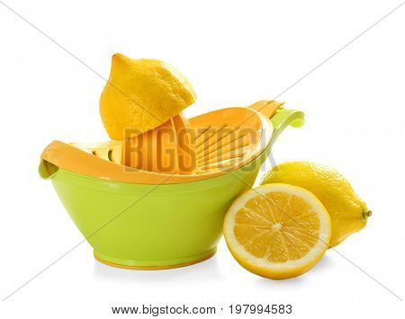 Squeezer and lemons on white background