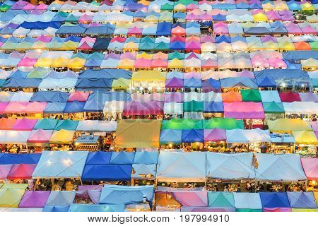 Train market secondhand market in Bangkok Thailand.photo of night market high view from building colorful tent retail shop and lighting.1 oct 2016 bangkok thailand