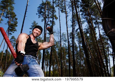 Strong Healthy Cheerful Adult Ripped Man With Big Muscles Workin