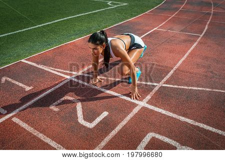 Woman Stands In A Low Start Position