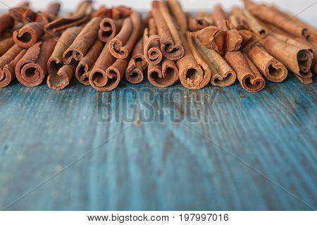 Aromatic cinnamon sticks on wooden surface
