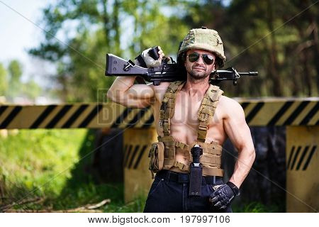 Powerful Mercenary With Submachine Gun Guarding A Roadblock