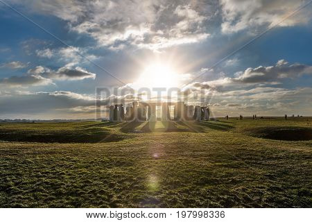 Stonehenge against the sun with reflections, Wiltshire, England