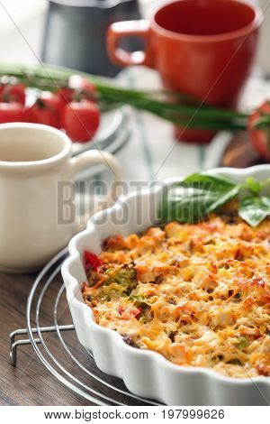 Baking dish with delicious turkey casserole on table