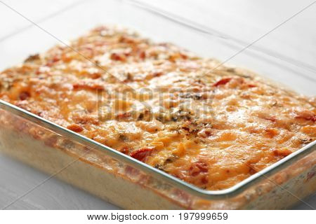 Baking tray with delicious turkey casserole on white table, closeup