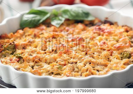 Baking dish with delicious turkey casserole on table, closeup