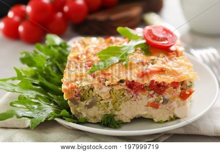 Plate with delicious turkey casserole on table, closeup