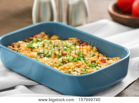 Baking tray with delicious turkey casserole on table