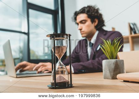 Selective Focus Of Businessman Typing On Laptop While Struggling To Meet Deadlines