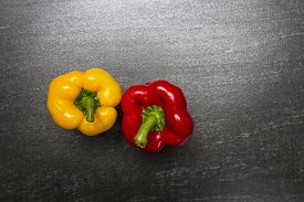 Raw sweet pepper. Sweet Pepper are rich sources of antioxidants and vitamin C.Top view with copy space. Dark background.