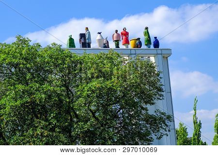 Lubeck, Germany - August 16, 2018: Strange Figures On The Roof Of Music And Congress Centre Of Lubec
