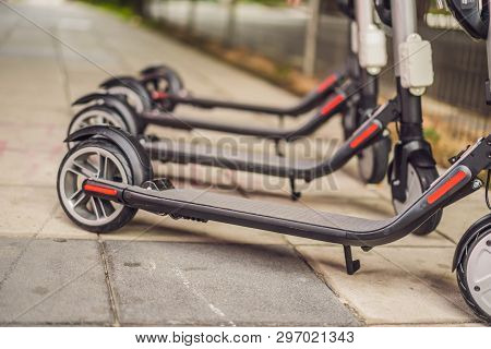 Electric Scooters For Rent. Urban Transport. Electric Ride Sharing Scooters Lined Up And Ready To Re